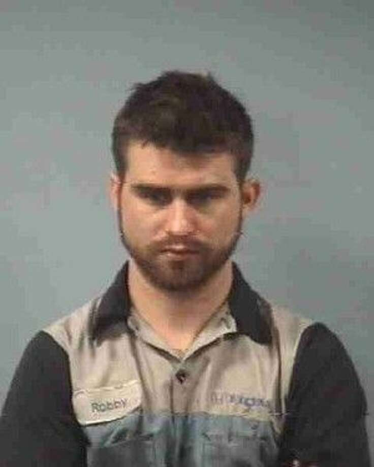 Robert Frank Newman, 25, of Friendswood is facing felony drug-possession charges after a witness recently called police to report a suspicious vehicle parked in a quiet residential neighborhood. Photo: Friendswood Jail