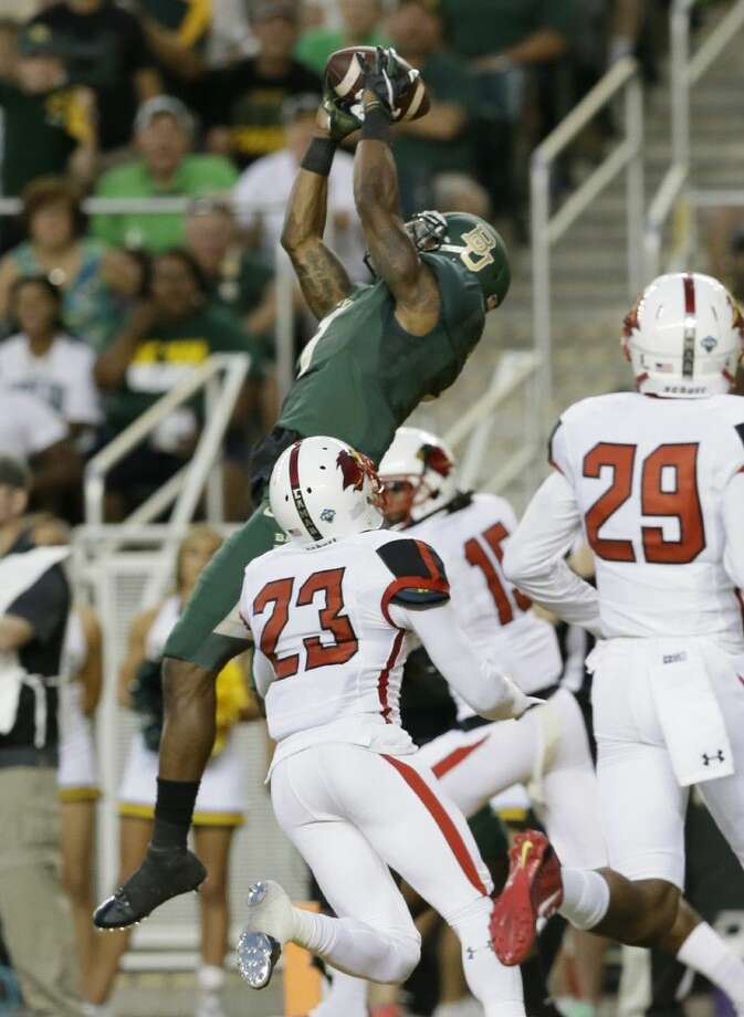 Baylor wide receiver Corey Coleman (1) catches a touchdown pass against Lamar defenders Lloyd Julian (23) and Xavier Bethany (29) Sept. 12.