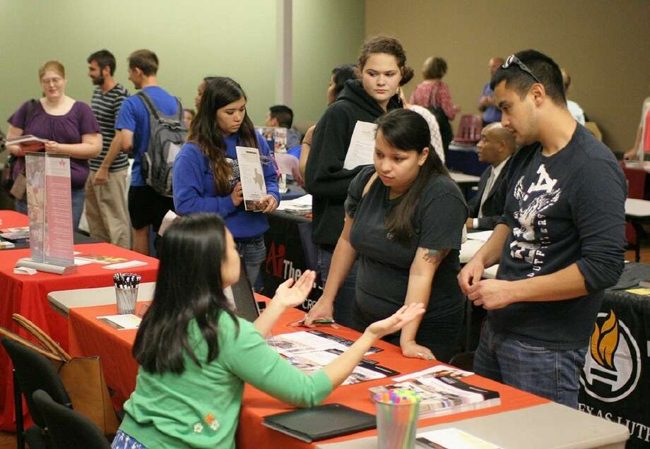 Students visit with recruiters during the annual University Day event in 2013.