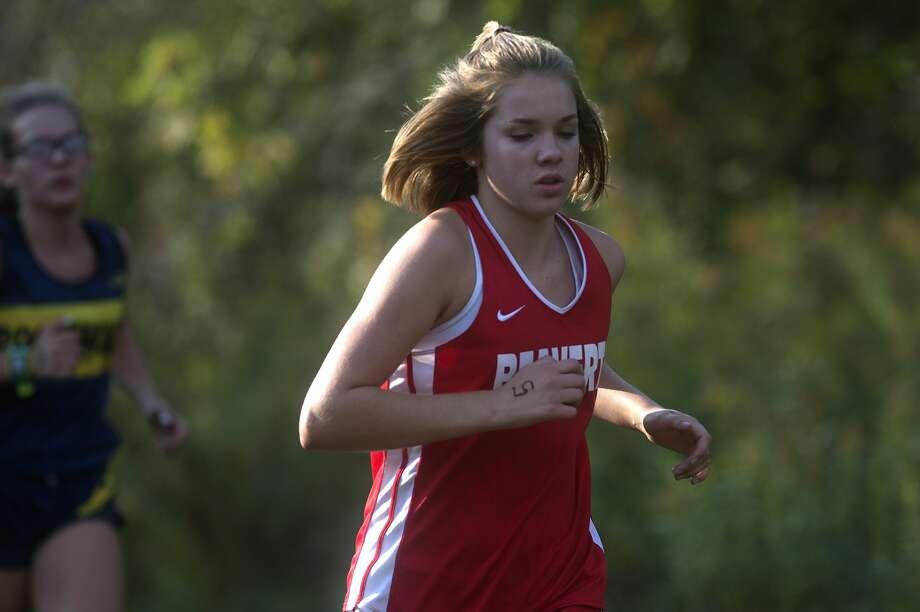 Beaverton's Abby Brushaber runs in the Jack Pine Jamobree at Samson Farm Wednesday afternoon. Photo: Brittney Lohmiller/Midland Daily News/Brittney Lohmiller