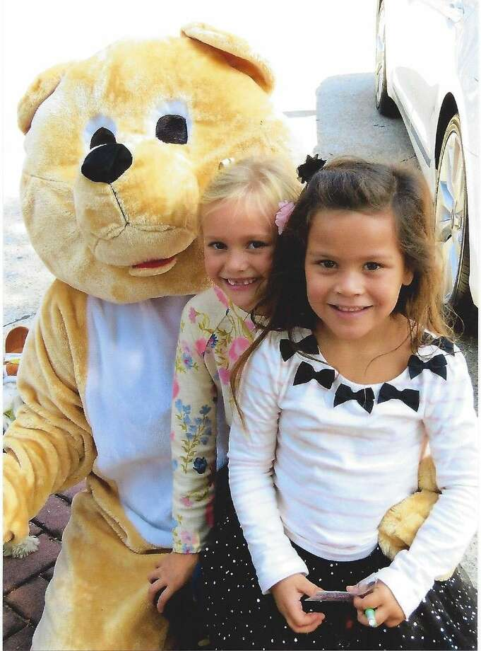"At the Humble Hyundai Car Show held Sunday Oct. 19 at Town Center, Kingwood, a big bear entertained visitors in the crowd, danced with the children, and helped the members of the ""Heartbeat Bears"" booth raise money for its' cause."