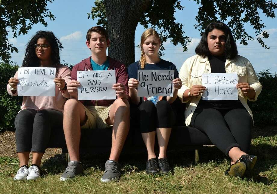 Cypress Creek students (L-R) Zuymar Bolivar, Cody Brockermeyer, Autumn Shelton and Joseph Concha display lines of dialogue from The Bright Blue Mailbox Suicide Note, a student-directed play about teens and suicide.