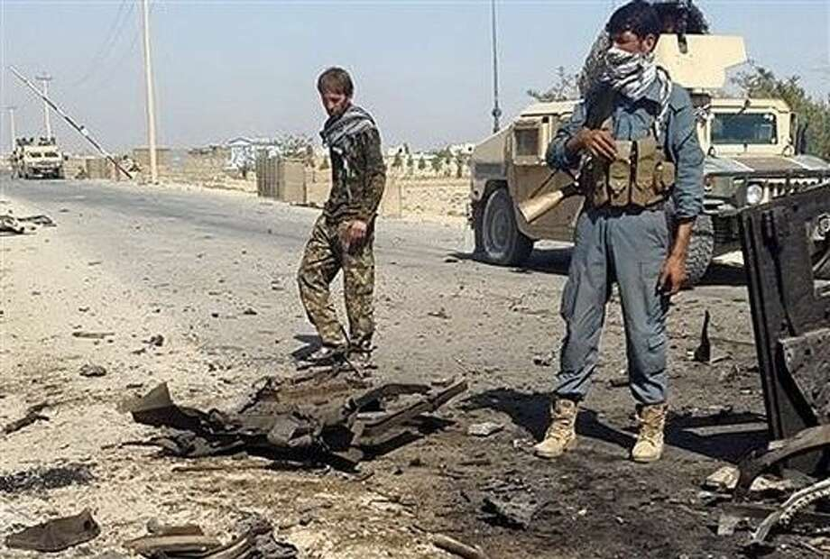 Afghanistan's security forces inspect the site of a U.S. airstrike, in Kunduz city, north of Kabul, Afghanistan, Thursday. Photo: STR