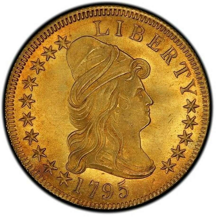 This undated file photo provided by Stack's Bowers Galleries shows a 1795 Capped Bust Right Eagle coin. It was worth $10 when it was minted and sold Wednesday for about 2.5 million. Photo: HONS