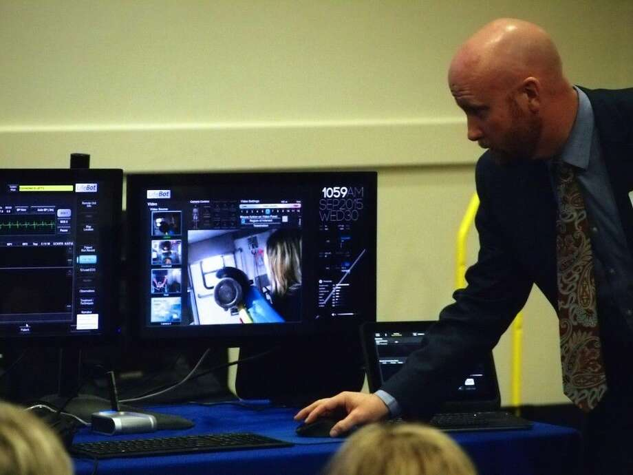 Kerry Fletcher demonstrates the operation of LifeBot with monitors like those installed in Liberty County EMS ambulances and communicates through a live link to a doctor at Methodist Hospital. Photo: Casey Stinnett