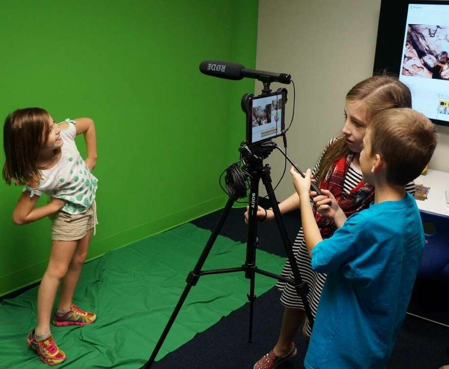 Cline's students show off how to use the green screen media room.