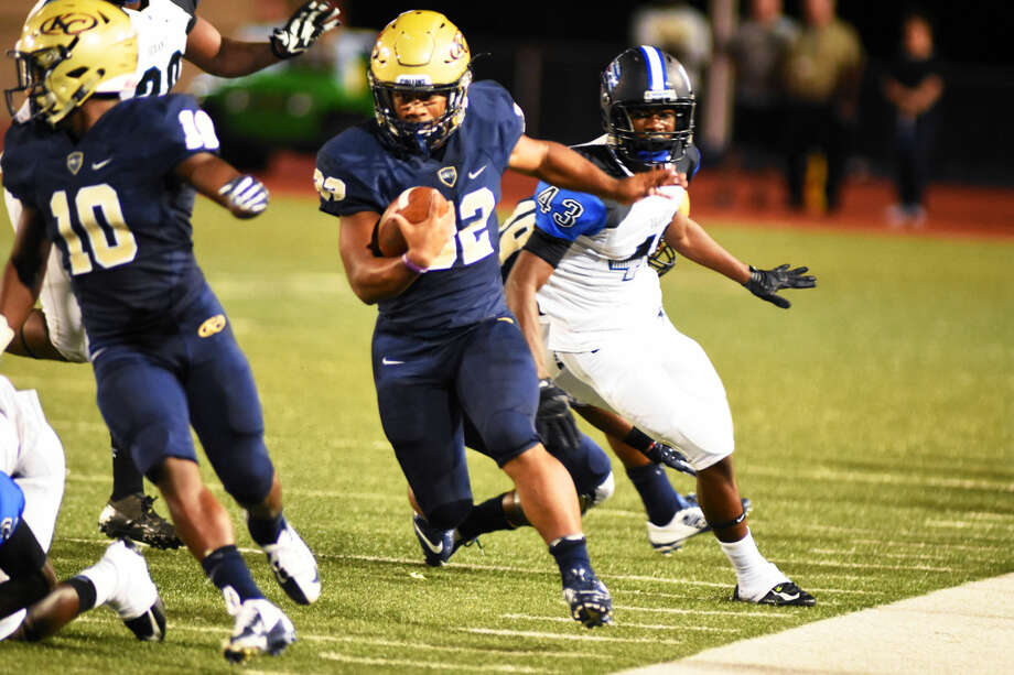 Klein Collins running back Justin Pratt (No.32) breaks off a 50-yard run for one of two touchdowns he scored against Dekaney Thursday night. Photo: Tony Gaines