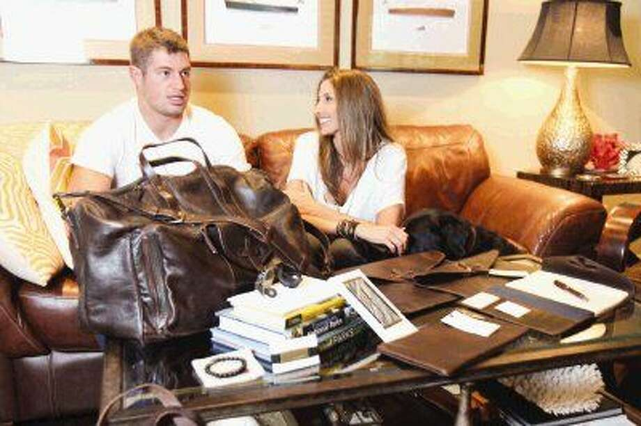 Philadelphia Eagles tight end Brent Celek and Woodlands native Jill Dilorio talk about how they started Revisit, a luxury brand of leather items with charity a portion of the proceeds benefiting National Parks, in The Woodlands Wednesday. Photo: Jason Fochtman