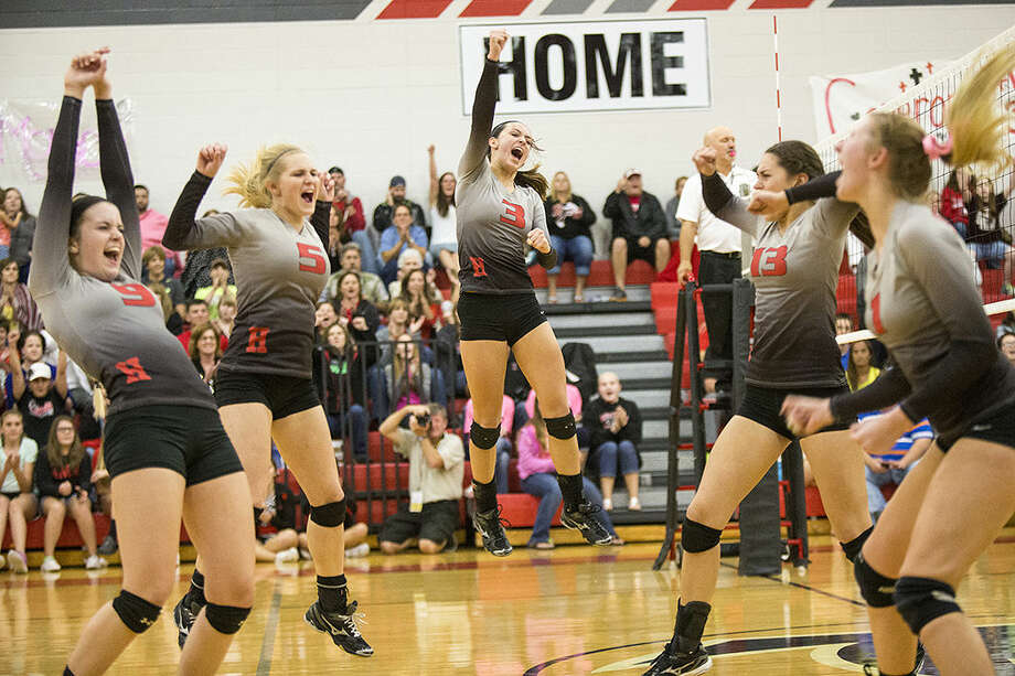 The Lady Falcons celebrate after a point during Huffman's 3-1 victory over Tarkington on Oct. 21, 2014, at Hargrave High School. Photo: ANDREW BUCKLEY