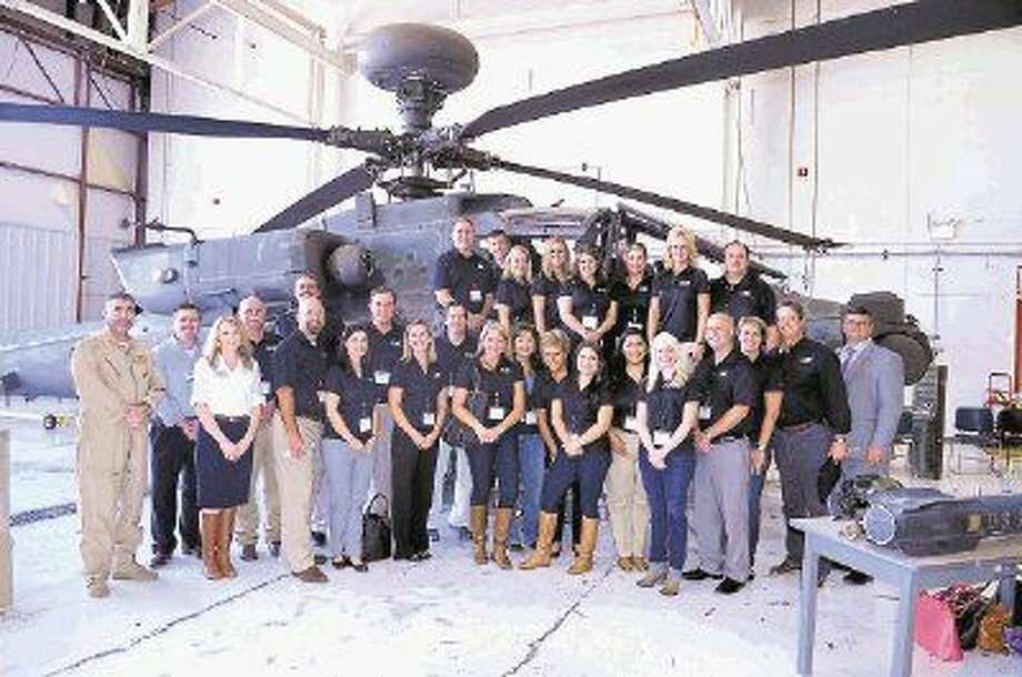 The Leadership Montgomery County Class of 2015 recently explored infrastructure in Montgomery County at the session sponsored by Entergy Texas. Class members got a look at the Apache helicopters at Lone Star Executive Airport.