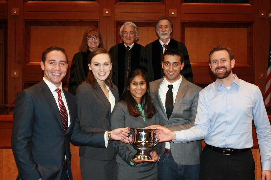 UT Law team (front row), with Friendswood's Nadia Ramkissoon center and Lone Star Classic judges (back row).