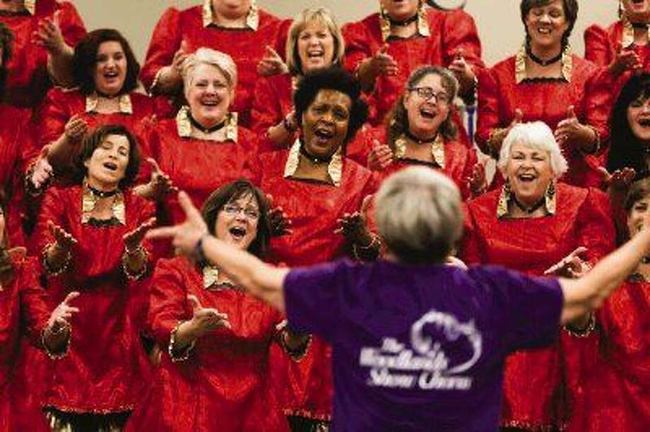 Betty Clipman, Master Director of The Woodlands Show Chorus, leads the chorus through some vocal exercises during the rehearsal for an upcoming concert on Monday, Oct. 20, 2014, at Grace Crossing Church. The chorus will be performing for Friends and Family Night at Grace Crossing Church on Oct. 27 before going to an international competition. Photo: Michael Minasi