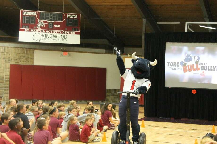 Toro the Texans mascot visits with students at St. Martha's Catholic School in Kingwood