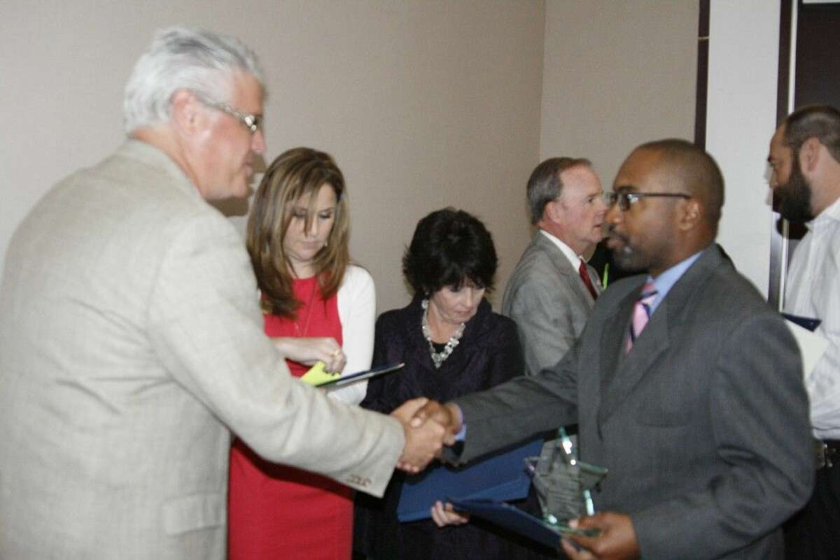 State Representative Dan Huberty shakes hands with a Teacher of the Year honoree at the Lake Houston Area Chamber of Commerce luncheon on Oct. 21, 2014.