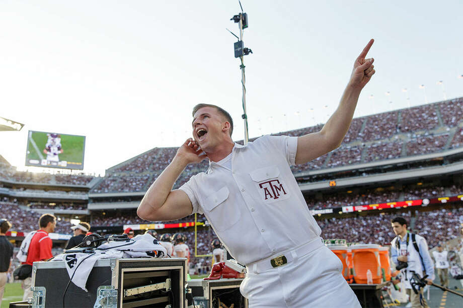Zach Lawrence leads an Aggie yell. Photo: Texas A&M University