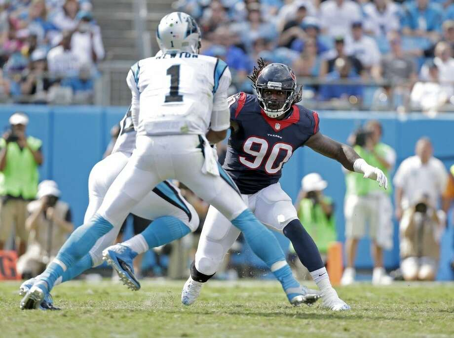 Houston Texans' Jadeveon Clowney (90) looks to stop the Carolina Panthers' Jonathan Stewart (28) and Cam Newton (1) earlier this season.