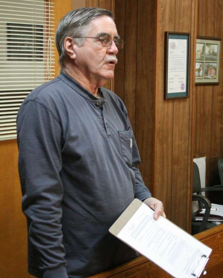 Lou Rogers speaks during public comments, asking the court to terminate the contract with Mega Prime Contractors. He began his comments by first asking the court to rethink their policy regarding public comments in regards to the previous commissioners court meeting. Photo: Jacob McAdams