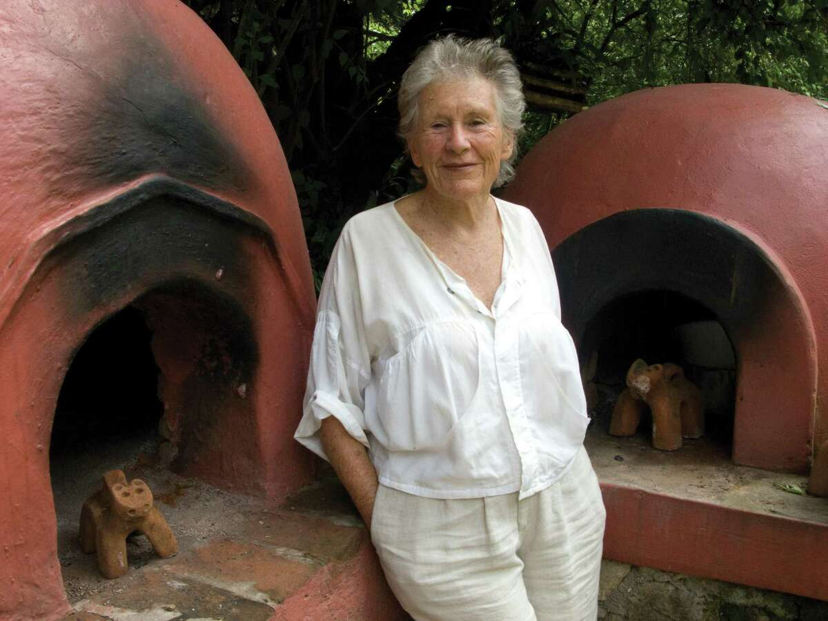 Diana Kennedy by a bread oven at her home in Michoacan, Mexico