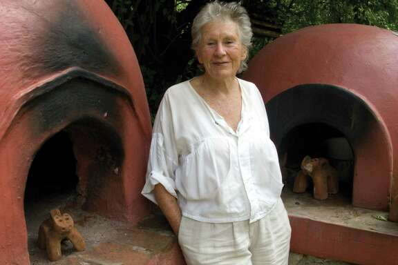 Diana Kennedy by bread oven at Quinta Diana in Michoacan, Mexico