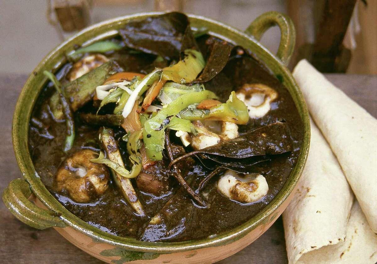 Dish of chichilo negro, one of many moles from Oaxaca.