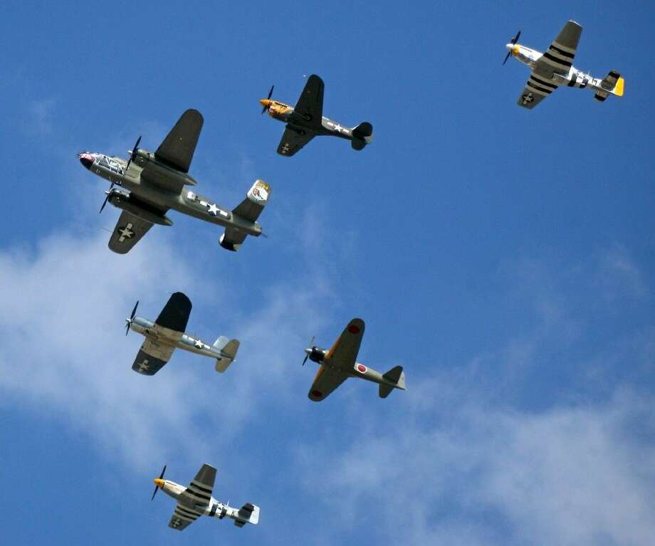 Vintage WWII aircraft fly over the crowd during Wings Over Houston. Photo: Kar B Hlava