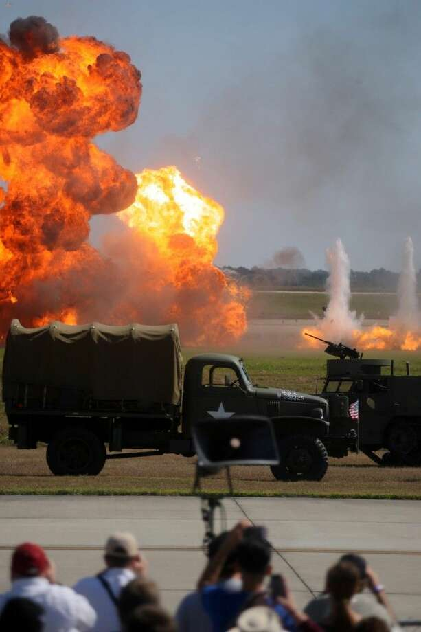 "Explosions and fire go off during the ""Tora Tora Tora"" reenactment at Wings Over Houston Airshow Saturday October 26, 2013 in Houston, Texas. Photo: Kar B Hlava"