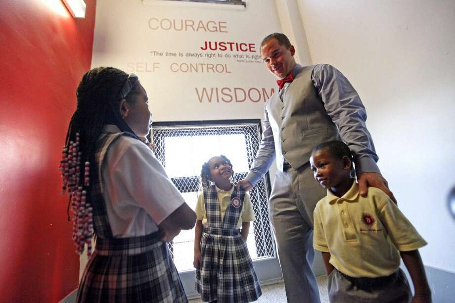 Principal Aaron Gillaspie with students at the Brilla College Prep Charter School in New York City. Gillaspie became Founder and Head of School of Brilla at the young age of 24. Photo: Angel Chevrestt