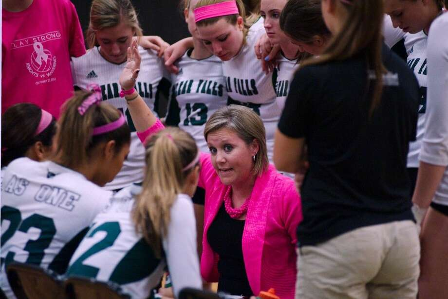 Clear Falls volleyball coach Lyndsay Hodges has some words for the Lady Knights during a timeout Tuesday against Clear Brook. Photo: KIRK SIDES