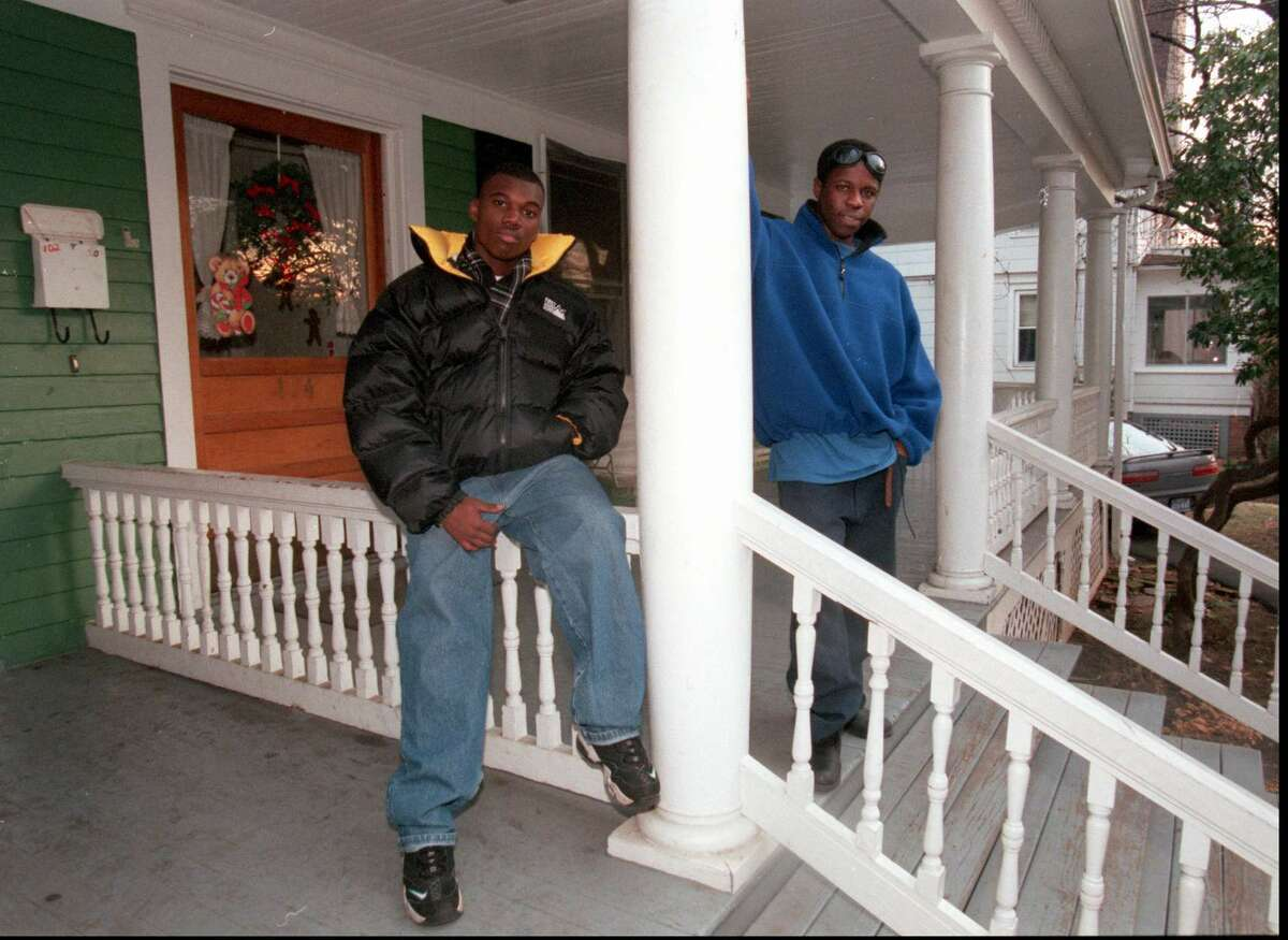 In this file photo from 1997, Greg Estivrne and Joel Pierre stand on the front porch of Domus House on Clinton Avenue, which was torn down last month. The young men were active participants in Domus programs. Staff Photograph by H. John Voorhees III