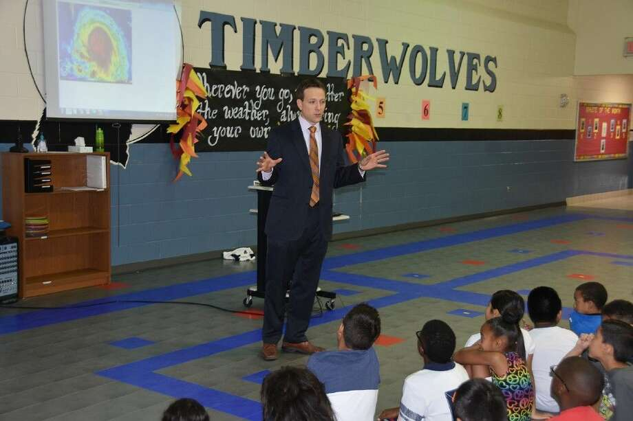 ABC 13 meteorologist Travis Herzog talks about weather patterns with McFee Elementary School students on Oct. 1.