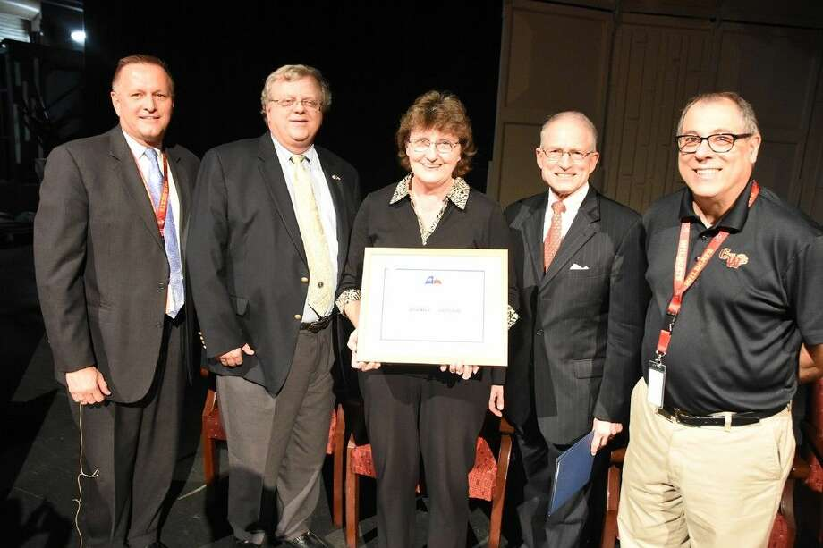 Retired CFISD educator Candace Tannous displays her Humanities Texas 2015 Outstanding Teaching of the Humanities Award at the Cypress Woods staff meeting on Oct. 1. Joining Tannous at the celebration were (L-R) Gary Kinninger, Cypress Woods principal; Sen. Paul Bettencourt, District 7 state senator; Chase Untermeyer, Humanities Texas board member and former ambassador to Qatar; and George Villamagna, Cypress Woods AP history and AP macroeconomics teacher.