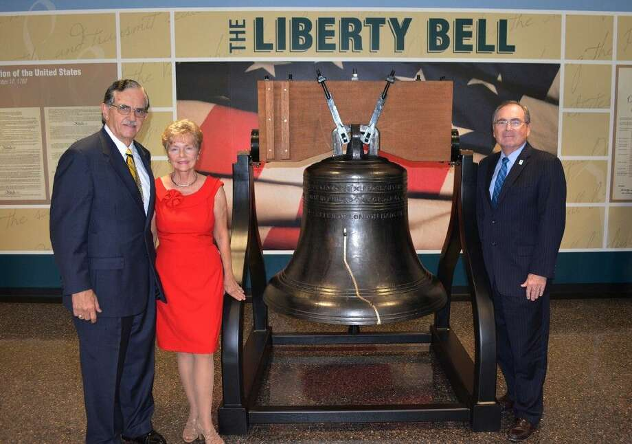 University of Houston-Clear Lake President William A. Staples (r) offered his appreciation to UH-Clear Lake Associate Professor of Legal Studies James Benson (l) and his wife, Susan, for their leadership in making the dream of adding a replica of the Liberty Bell to UHCL a reality. The bell is available for all to enjoy and is located in the north lobby of the university's Bayou Building, 2700 Bay Area Blvd., Houston.