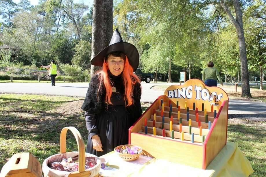 Nancy Ramirez sets up a ring toss game for Jones Park's Tricks & Treats Among the Trees.