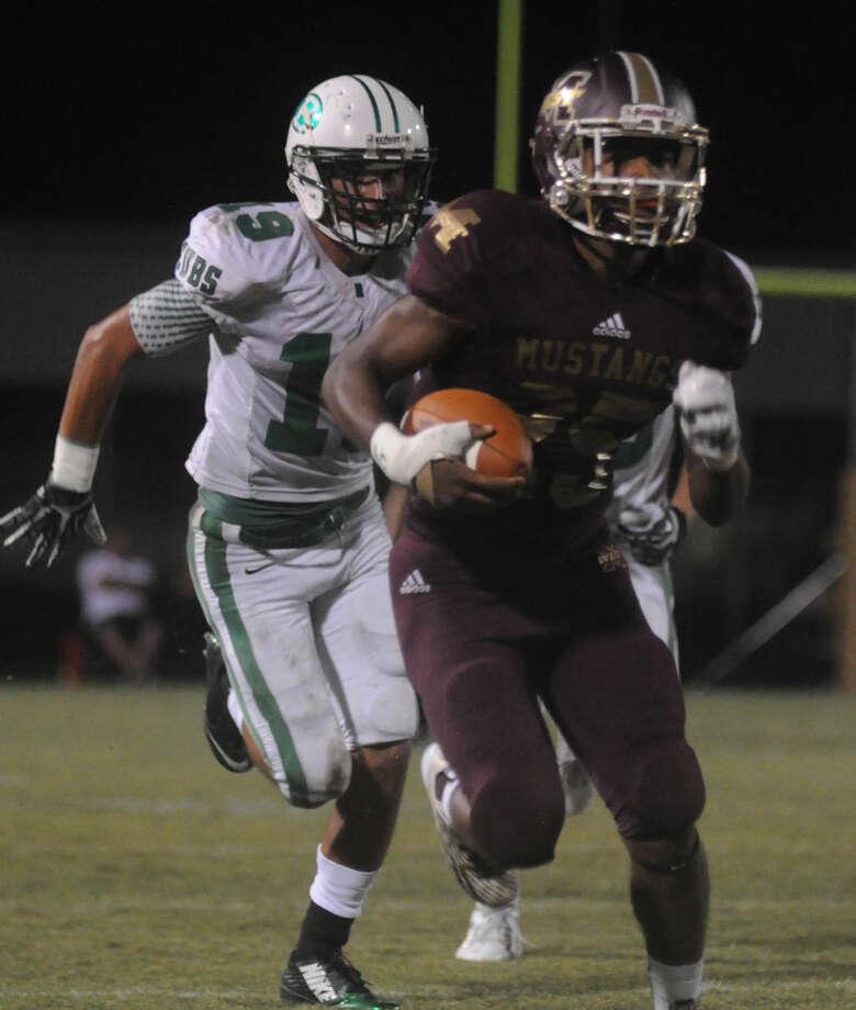 Magnolia West's Aaron Thomas runs the ball against Brenham at Mustang Stadium on Friday in Magnolia. Photo: Keith MacPherson