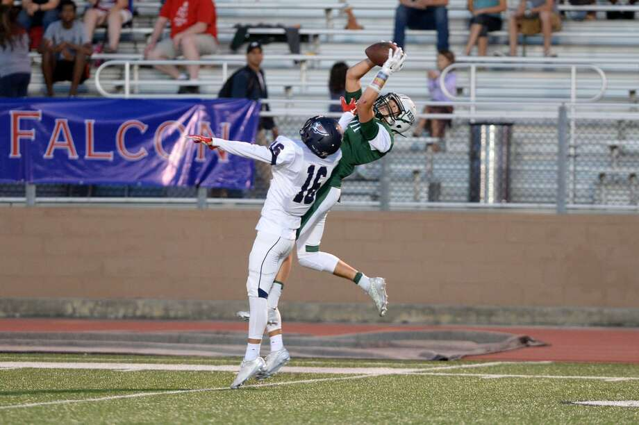 Strake Jesuit's Christian Charbonnet makes a leaping catch despite the efforts of Tompkins' Tim Thomson, Oct. 2 at Crusader Stadium. The Crusaders won 42-21. Visit HCNPics for more photos. Photo: Craig Moseley
