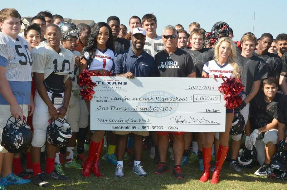 Houston Texans cheerleaders Lesha, left, and Brittany, join Brett Stewart in presenting a 1,000 check to the Langham Creek athletics program in honor of coach Todd Thompson winning the Houston Texans Coach of the Week award. Photo: Submitted Photo