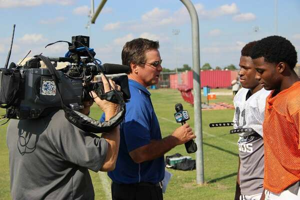 ABC 13 sports reporter Bob Slovak interviews Ch. 13 High School Highlights Players of the Week Toneil Carter, left, and Paul Watson during practice on Oct. 20.