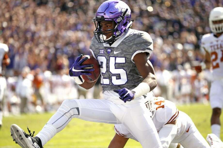 TCU wide receiver KaVontae Turpin takes a touchdown pass across the goal line Saturday in Fort Worth.