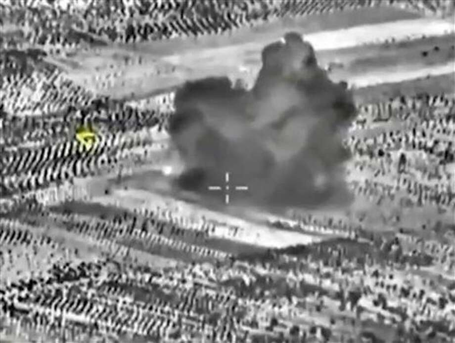 The Russian Defense Ministry says its aircraft have carried out 18 sorties in Syria in the past 24 hours, including 10 overnight in which seven sites were bombed. The annotations on the image were made by the source and indicate the center of the target, and its direction, yellow. Photo: HOGP