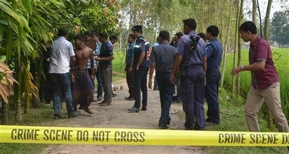 Bangladeshi security officers stand by the site where a Japanese Kunio Hoshi was killed at Mahiganj village in Rangpur district, 300 kilometers (185 miles) north of Dhaka, Bangladesh, Saturday. Photo: Ripon Islam