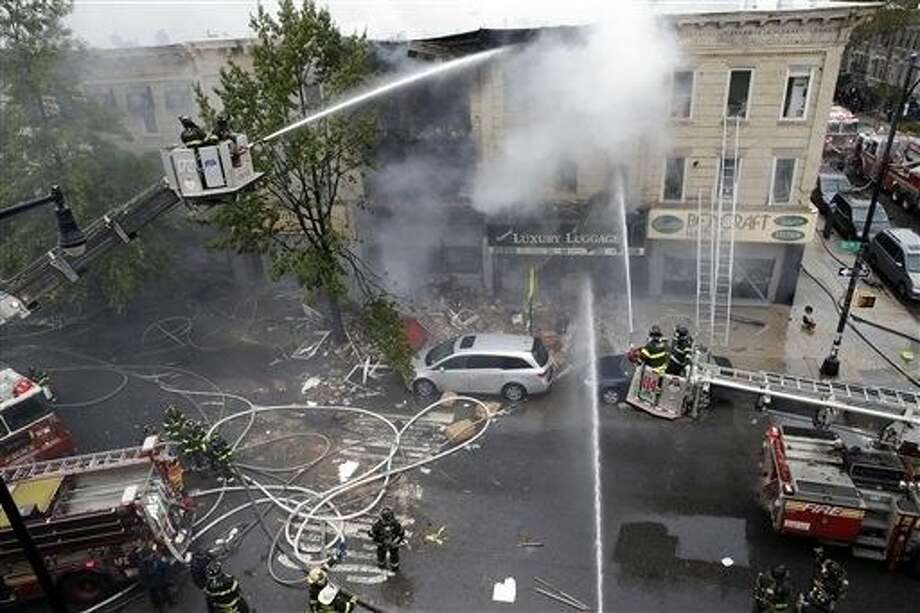 Firefighters work at the at the scene of an explosion at a three-story building in the Borough Park neighborhood in the Brooklyn borough of New York, Saturday. Photo: Mary Altaffer