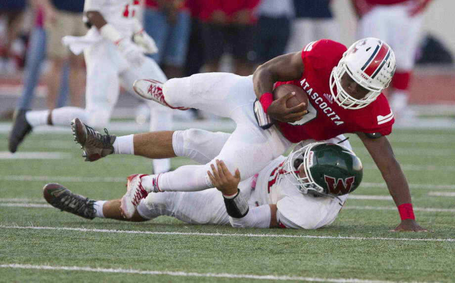 The Woodlands linebacker Zach La Canfora tackles Atascocita running back Kameron Jones during a football game Saturday. To view or purchase this photo and others like it, visit HCNpics.com. Photo: Jason Fochtman