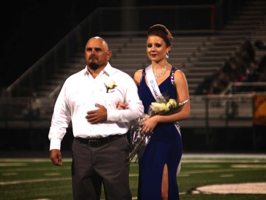 Dayton High School's 2015 Homecoming Queen Milena Gulbe waits with her father for the announcement during half time, Oct. 2, 2015. Photo: Casey Stinnett