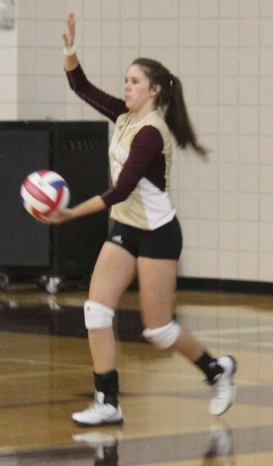 Desiree Higgins (3) of the Lady Horns prepares to make a serve. Photo: Jacob McAdams