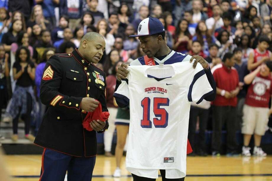 Cypress Ridge senior wide recCypress Ridge senior wide receiver Keham Siverand is presented with the Marine Corps Semper Fidelis All-American Bowl jersey during the Rams' pep rally on Oct. 17.