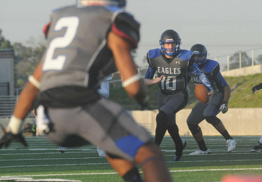 New Caney's Timmy Ware carries the ball up field against Humble at Texan Drive Stadium on Saturday. Photo: Keith MacPherson