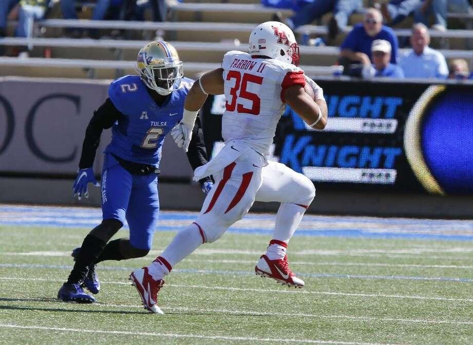 Houston's Kenneth Farrow runs toward the end zone during the second half of an NCAA college football game against Tulsa Saturday in Tulsa, Okla.