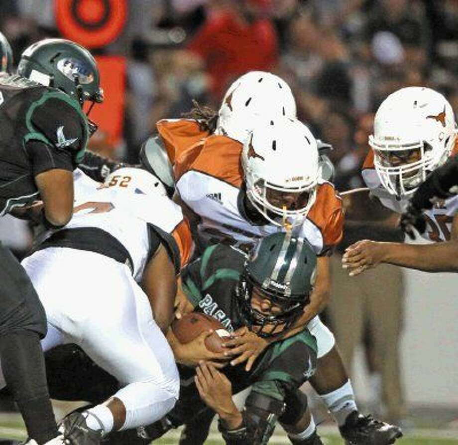Dobie defense kept Pasadena to under 180 yards during Friday night's 47th annual get-together. The Longhorns used the win to raise their PISD winning streak to 11 straight. Photo: Kar B Hlava