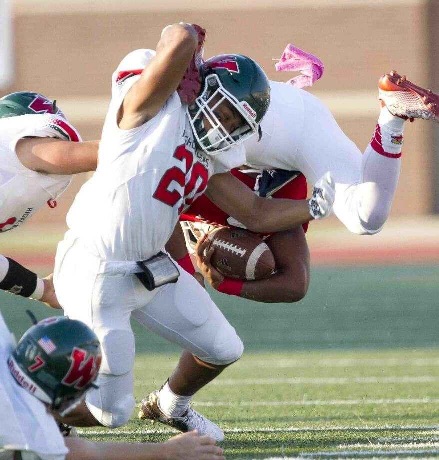 The Woodlands defensive back Antoine Winfield Jr. flips Atascocita quarterback Daveon Boyd Saturday.
