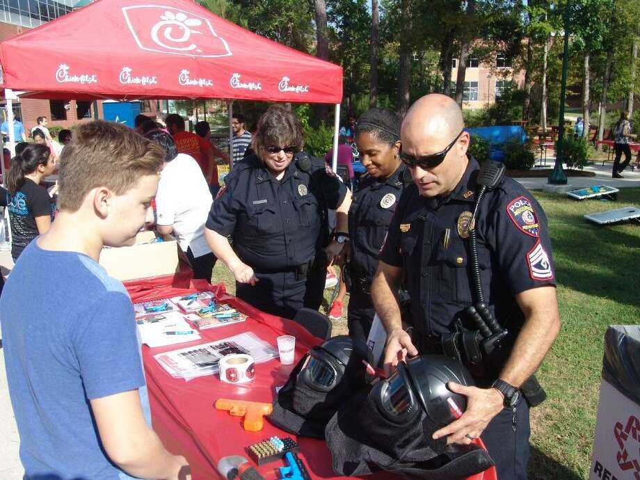 Law enforcement and students gather in Maverick Square at Lone Star College - Montgomery last year in hopes of strengthening the police-community bond. The college will host Campus Night Out from 4-7:30 p.m. Oct. 6.